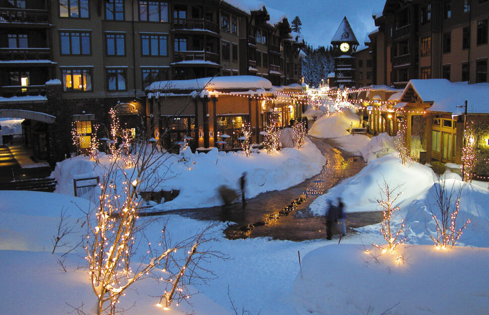 Winter evening outside Village at Mammoth condominiums, Mammoth Mountain, California, USA.